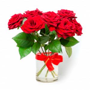 6 rosas en florero vidrio